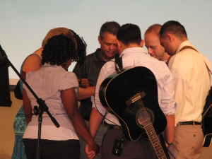 Worship team praying